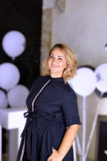 Анна Озолина